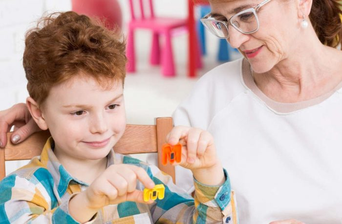 Squared photo of occupational therapist and little boy